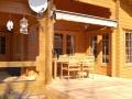 Terrasse mit Holzmöbeln - Ferienhaus Strandgut - Ferienhäuser in Ahrenshoop