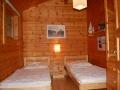 Schlafzimmer mit 2 Einzelbetten - Ferienhaus Strandgut - Ferienhäuser in Ahrenshoop