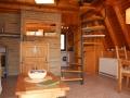 Wohnzimmer mit Blick auf Treppe und Küche - Ferienhaus Ferienzeit - Ferienhäuser in Ahrenshoop